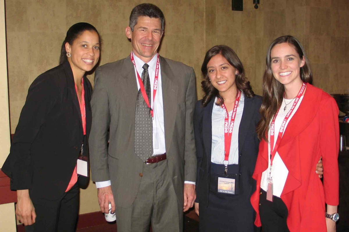 Medical students stand with Otolaryngology Lecturer Robert B. Cravens, Jr., MD at an ENT in the Desert Conference
